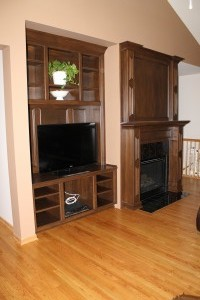 Added an entertainment unit in alcove and built up the mantel.